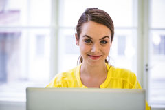 Portrait of confident businesswoman with laptop at office Royalty Free Stock Images