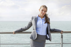 Portrait of confident businesswoman leaning on terrace railings Stock Image