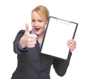 Portrait of a confident businesswoman showing empty sign clipboard Stock Photos