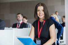 Portrait of confident businesswoman sitting in seminar hall Royalty Free Stock Photo