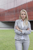 Portrait of confident businesswoman standing with arms crossed against office building Royalty Free Stock Photo