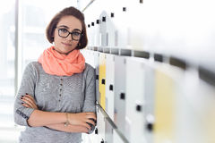 Portrait of confident businesswoman standing arms crossed in locker room at creative office Royalty Free Stock Photography