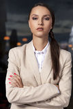 Portrait of confident businesswoman standing arms crossed in office Stock Photos