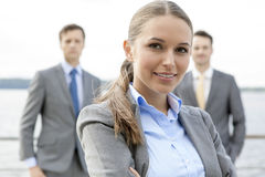 Portrait of confident businesswoman standing with coworkers on terrace Royalty Free Stock Photos