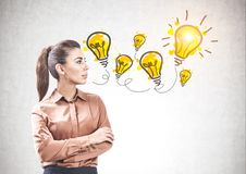 Confident business woman and her idea stock images