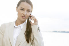 Portrait of confident businesswoman using cell phone outdoors Stock Image