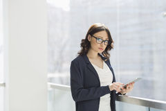 Portrait of confident businesswoman using tablet PC in office Stock Photos