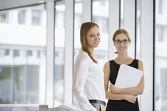 Portrait of confident businesswomen with documents in office Stock Images