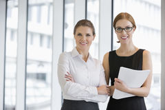 Portrait of confident businesswomen with documents in office Royalty Free Stock Photo