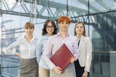 Portrait of confident businesswomen standing together in office Stock Photos