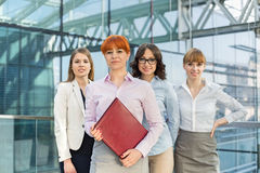 Portrait of confident businesswomen standing together in office Stock Images