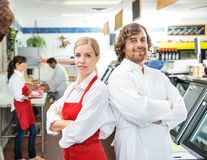Portrait Of Confident Butchers With Arms Crossed Stock Images
