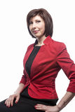 Portrait of Confident Caucasian Business Brunette Woman Posing in Red Suit Against White. Royalty Free Stock Photo