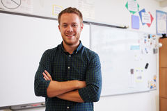 Portrait of confident Caucasian male teacher in classroom Royalty Free Stock Photo