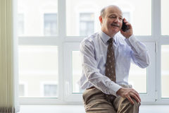 Portrait of confident caucasian man with phone Royalty Free Stock Photos