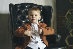 Portrait of confident child showing thumbs up isolated one white royalty free stock images