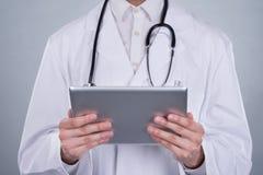Portrait Of Confident Doctor Holding Digital Tablet Stock Photo
