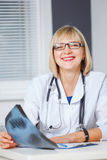 Portrait of confident doctor looking at camera. Stock Photo