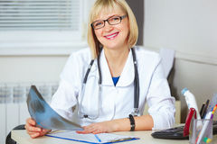 Portrait of confident doctor looking at camera. Royalty Free Stock Photography