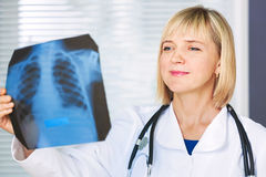 Portrait of confident doctor looking at xray. Stock Photo