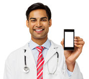 Portrait Of Confident Doctor Showing Smart Phone Stock Photos