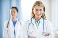Portrait Of Confident Doctor Standing In Clinic Stock Image