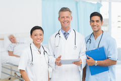 Portrait of confident doctors with arms crossed. At medical office Stock Image