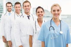 Portrait of confident doctors in row Stock Photo