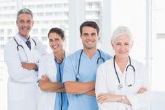 Portrait of confident doctors in row Stock Image