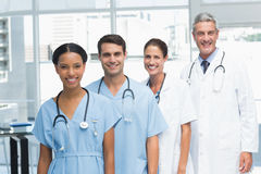 Portrait of confident doctors in row Stock Images