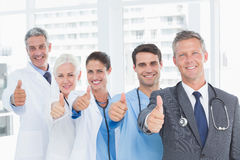Portrait of confident doctors in row thumbs up. In the hospital Royalty Free Stock Image