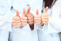 Portrait of confident doctors team showing Royalty Free Stock Photo