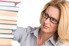 Portrait of confident female advocate looking at books. Teacher at table with books on white background Stock Photo