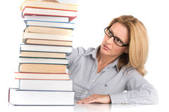 Portrait of confident female advocate looking at books. Teacher at table with books on white background Royalty Free Stock Images