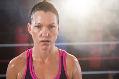 Portrait of confident female boxer Stock Photos