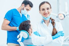 Portrait of a confident female dentist looking at camera in the dental office Royalty Free Stock Images