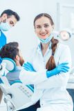 Portrait of a confident female dentist looking at camera in the stock photography