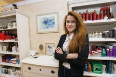 Portrait of confident female hairstylist in beauty salon Royalty Free Stock Photo