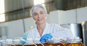 Portrait of confident female technician standing with arms crossed 4k stock video