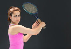 Portrait of confident female tennis player with racquet Stock Photos