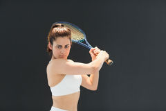 Portrait of confident female tennis player with racquet Stock Photo