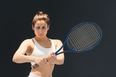 Portrait of confident female tennis player with racquet Royalty Free Stock Image