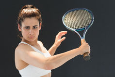 Portrait of confident female tennis player with racquet Stock Image