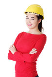 Portrait of confident female worker in helmet. Royalty Free Stock Images