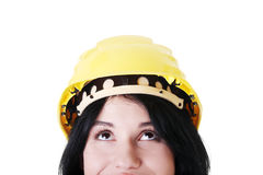 Portrait of female worker in helmet looking up. Stock Photography