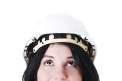 Portrait of female worker in helmet looking up. Royalty Free Stock Images