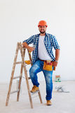 Portrait of confident foreman, professional near ladder Royalty Free Stock Photos