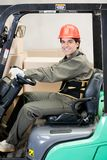 Portrait Of A Confident Forklift Driver Stock Image