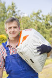 Portrait of confident gardener carrying sack in plant nursery Royalty Free Stock Photo