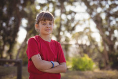 Portrait of confident girl standing with arms crossed. In boot camp stock images